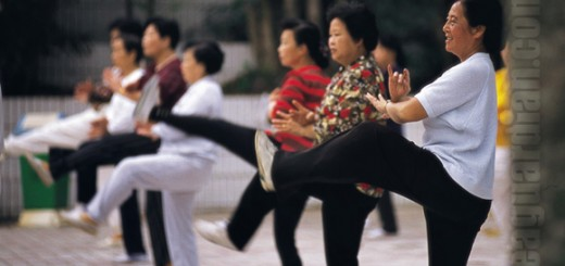 A group playing a taichi dance in the corner of a small park, Ch