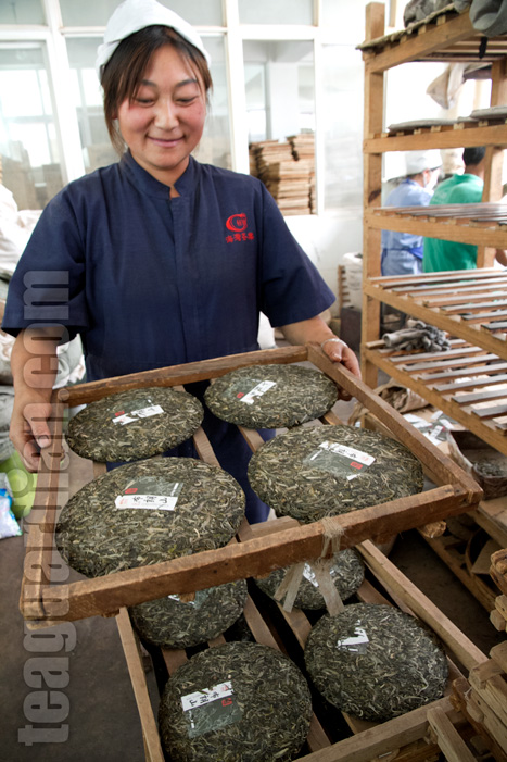 Worker with freshly compressed cha bing